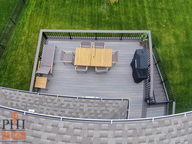 Gray-decking-cocktail-railing-gate-capped-composite-decking