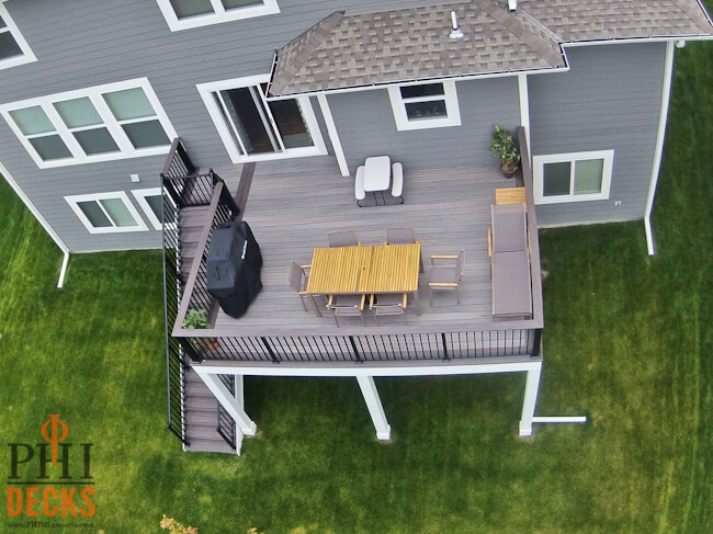 Low-maintenance-timbertech-decking-cocktail-railing-wrapped-posts