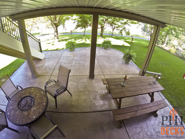 stamped-colored-concrete-patio-below-deck